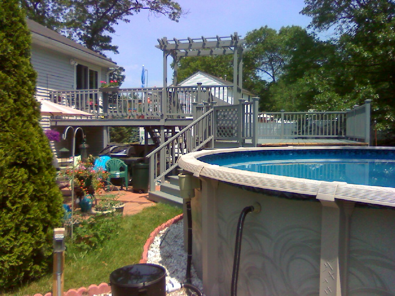 Ground level deck2 smjpg pictures for Above ground pool gate ideas